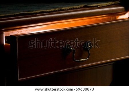 Mystery light from the wooden drawer. Mystery concept. - stock photo