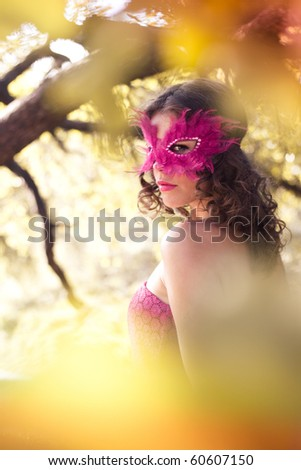 Mystery woman in carnival mask. Autumn - stock photo