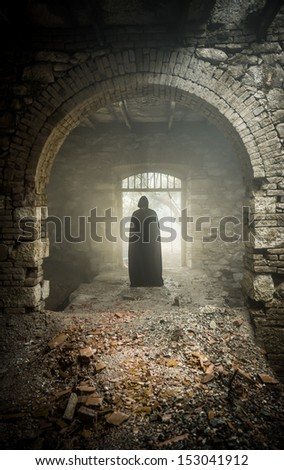 mystic apparition of a ghost in a medieval castle - stock photo