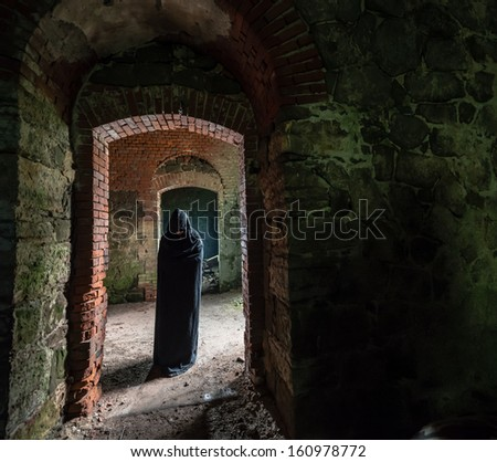 Mystic apparition of a ghost in an old castle - stock photo