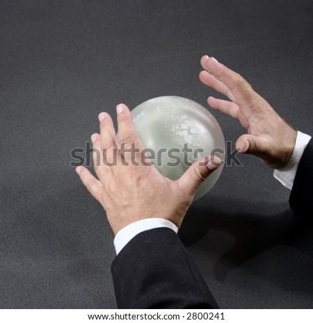 mystic businessman makes predictions - stock photo