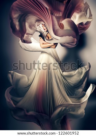 mystic dark woman with flying white dress - stock photo