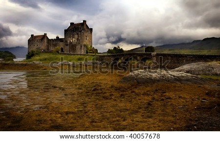 Mystic Eilean Donan Castle with lake Scotland - stock photo