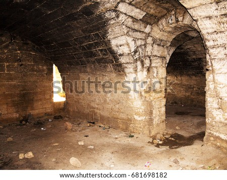 Mystic interior of an ancient dungeon. An old abandoned tunnel in an underground wine cellar & Mystic Interior Ancient Dungeon Old Abandoned Stock Photo (Safe to ...