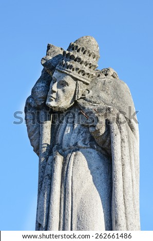Mystic old stone statue with rolled away head on the headstone in the cemetery in Ukraine - stock photo