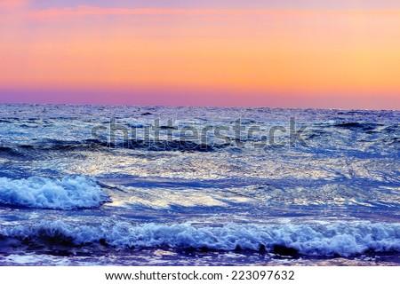 mystic rising sun on the orange horizon ocean  - stock photo