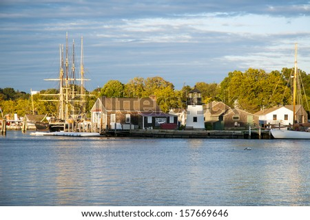 Mystic Seaport, is an outdoor recreated 19th century village and educational maritime museum. Visitors will find a lighthouse replica of Brant Point Light. - stock photo