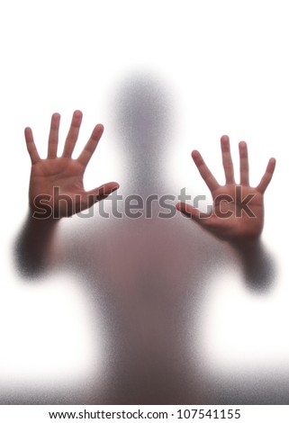 mystic silhouette man against transparent wall stock photo
