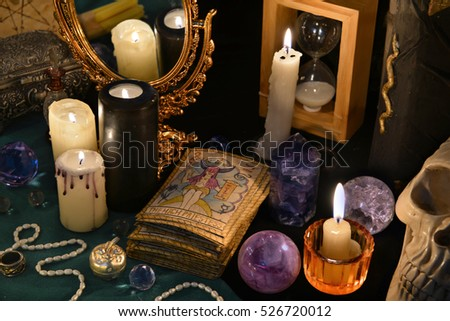 with the Tarot cards, mirror and burning candles. Halloween concept ...