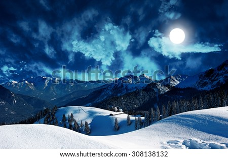 mystic winter landscape in the mountains with full moon - stock photo