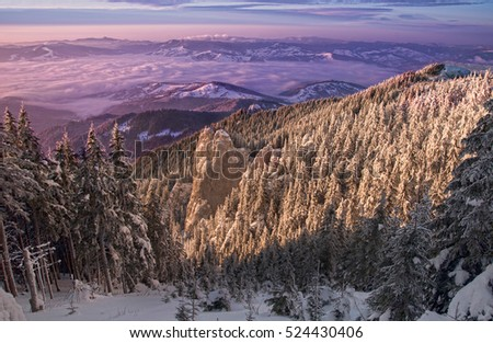 mystic winter sunset in Romanian Carpathians