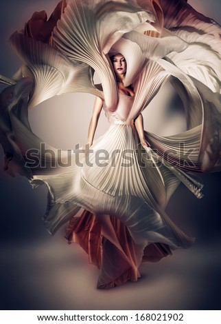 mystic woman with flying white dress - stock photo