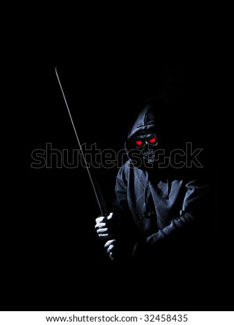 mystical bony creature with red eyes and sword - stock photo