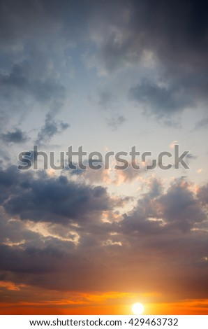 Mystical dramatic clouds on the sunset background. Nature composition sunset - stock photo