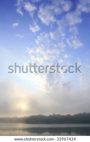 mystical landscape over haze lake, cloud over beautiful dawn, small hours of the morning - stock photo