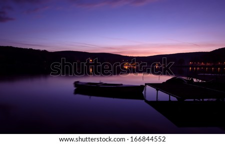 Mystical landscape, the boat harbor at dawn - stock photo