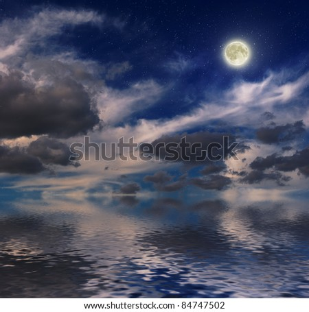 mystical night sky over endless water - stock photo