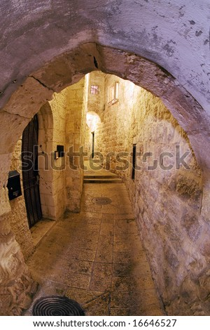 Mystical street at night in the old city of Jerusalem. - stock photo