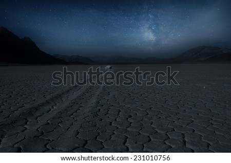 Mystique sailing rock  under night sky and milky way - stock photo