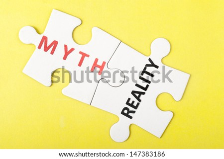 Myth and reality words on two pieces of puzzle - stock photo