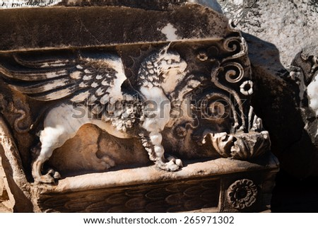 Mythical griffon, relief carved in stone of ancient temple, Didyma, Turkey - stock photo