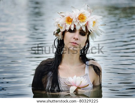 mythological creature, a mermaid in the wreath of the lotus - stock photo