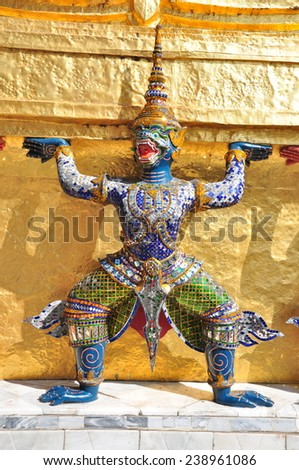 Mythological figure of the indian epic ramayana, the demon guardian, guarding the buddhist temple in the grand palace, Bangkok  - stock photo