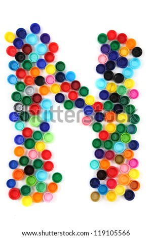 N - alphabet from the plastic caps isolated on the white background
