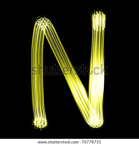 N - Created by light alphabet over black background - stock photo