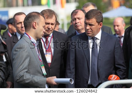 N.TAGIL, RUSSIA- AUG 22: Governor of Sverdlovsk region Evgeny Kuyvashev and Director Ural Works of Civil Aviation Vadim Badekha at RUSSIAN DEFENCE EXPO 2012 on August, 22, 2012 in Nizhny Tagil, Russia