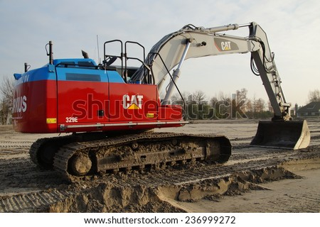 Naarden, THE NETHERLANDS - DECEMBER 5, 2014: caterpillar (CAT) excavator sits at rest on a construction site