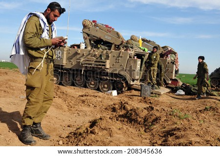 NACHAL OZ, ISR - DEC 29 2008:Israeli soldier prays during the final preparation of the IDF for a possible land incursion into Gaza strip  during cast lead operation. - stock photo