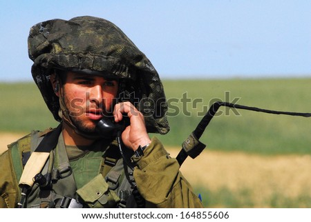 NACHAL OZ, ISR - JAN 27:Israeli soldiers near Gaza strip on Jan 27 2009. Israel has one of the highest recruitment rates in the world - some 80% of those who receive summons serve. - stock photo