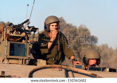 NACHAL OZ, ISR - JULY 01:Israeli soldiers in armed vehicle on July 01 2006.IDF is one of Israeli society's most prominent institutions, influencing the country's economy, culture and political scene. - stock photo