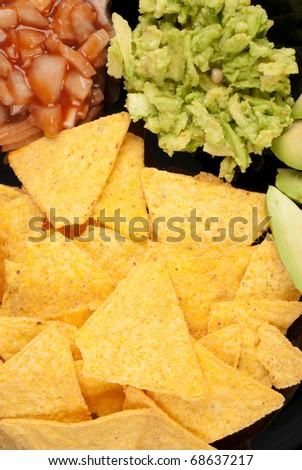 Nacho tortilla chips with dips and avocado - stock photo