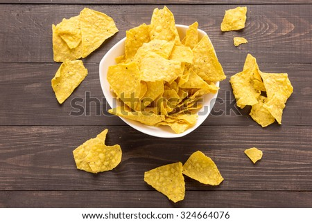 Nachos chips on wooden background. Top view. - stock photo