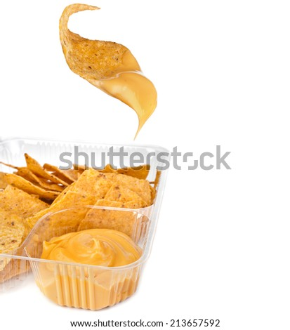 nachos chips with cheese sauce in plastic container on white background - stock photo