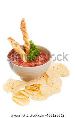 Nachos chips with fresh homemade salsa isolated on white. - stock photo