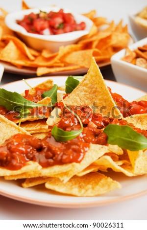 Nachos corn chips with fresh homemade chili sauce - stock photo