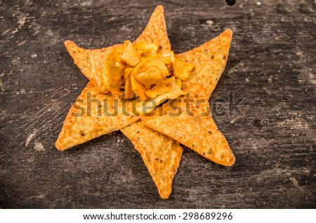 nachos laying on a wood table - stock photo
