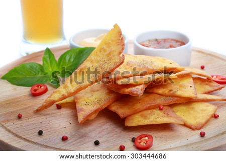 Nachos  on wooden desk and beer - stock photo