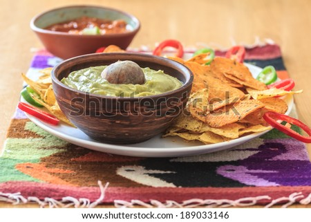 Nachos with avocado guacamole, hot pepper and salsa