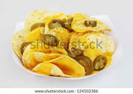 Nachos with extra cheese and peppers - stock photo
