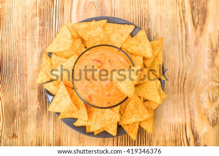 nachos with salsa on rustic wood - stock photo