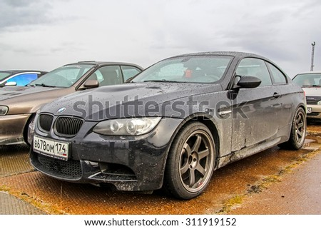 NADYM, RUSSIA - AUGUST 29, 2015: Motor car BMW E92 M3 at the city street. - stock photo