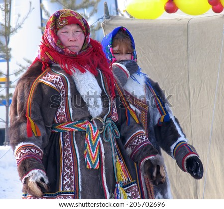 Nadym, Russia - March 18, 2006: the national holiday, the day of the reindeer herder in Nadym, Russia - March 18, 2006. Unknown woman - Nenets, closeup, on the street.