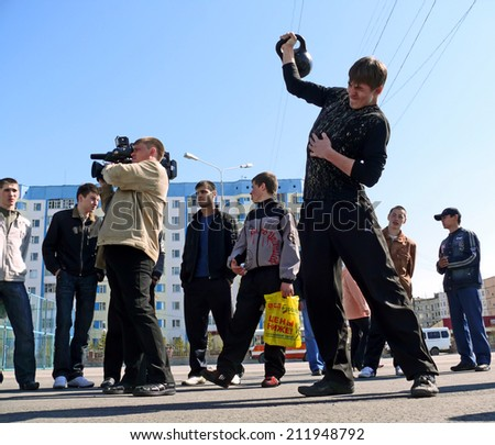 Nadym, Russia - May 17, 2008: the Competitions in sport in Nadym, Russia - May 17, 2008. Unknown men compete in raising the weights.