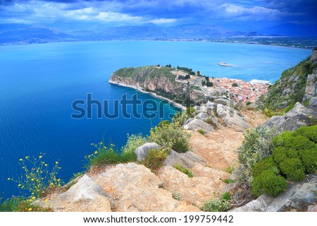 Nafplio town and harbor seen from above in overcast day, Greece
