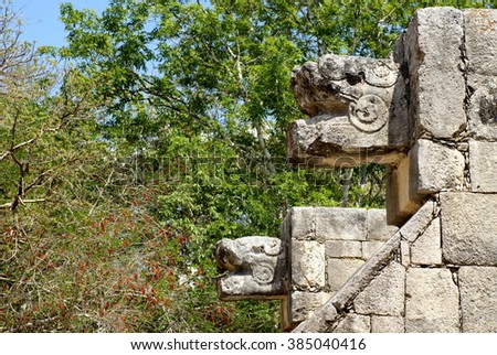 Naga head sculptures on the side of the Mayan ball court in Chichen Itza - stock photo