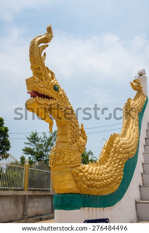 Naga serpent golden in an ancient temple of Thailand - stock photo